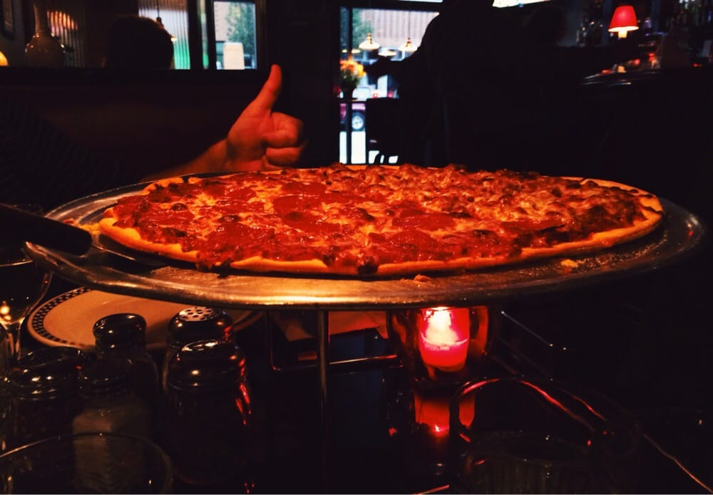 Photo of Gino's North Pizzeria - Chicago, IL, United States. cracker crust, real pepperoni