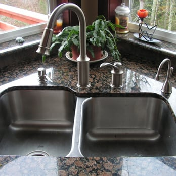 Moen Aberdeen kitchen faucet with soap dispenser to left and ...