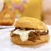 Photo of Cafe De Casa - San Francisco, CA, United States. Pão de Queijo Sandwich w/ Brazilian dried beef, mozzarella | $6