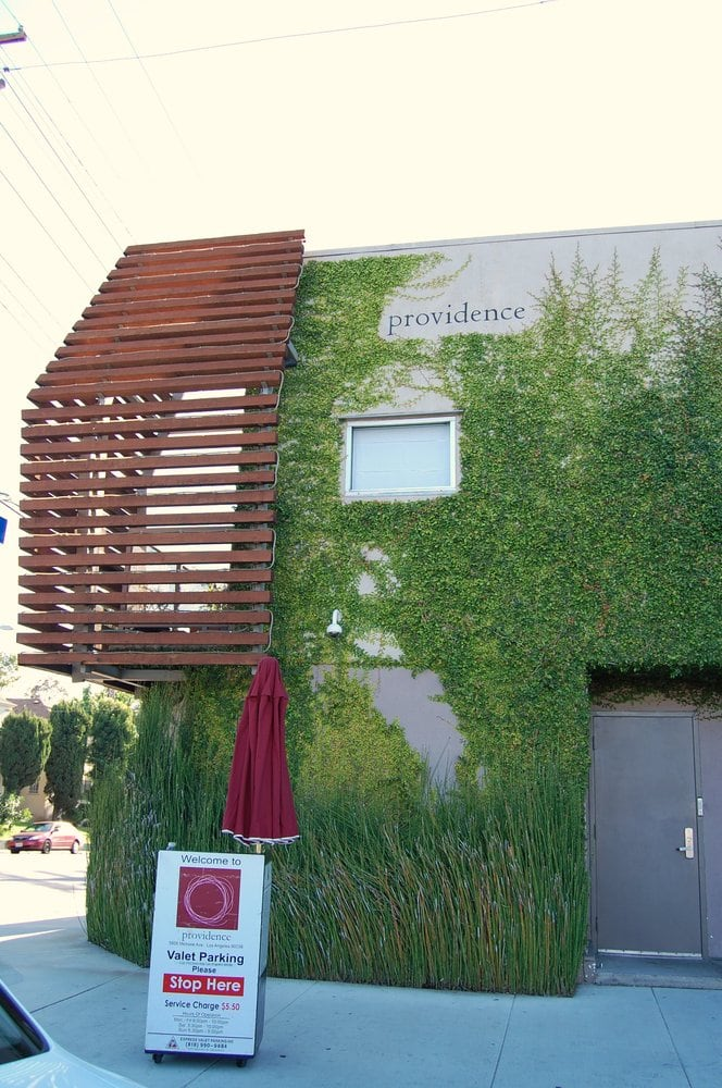 Photo of Providence - Los Angeles, CA, United States. Side of building next to the valet