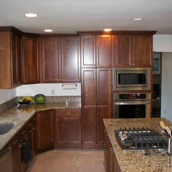 Tall cherry kitchen cabinets in Portland Oregon. Quartz ...