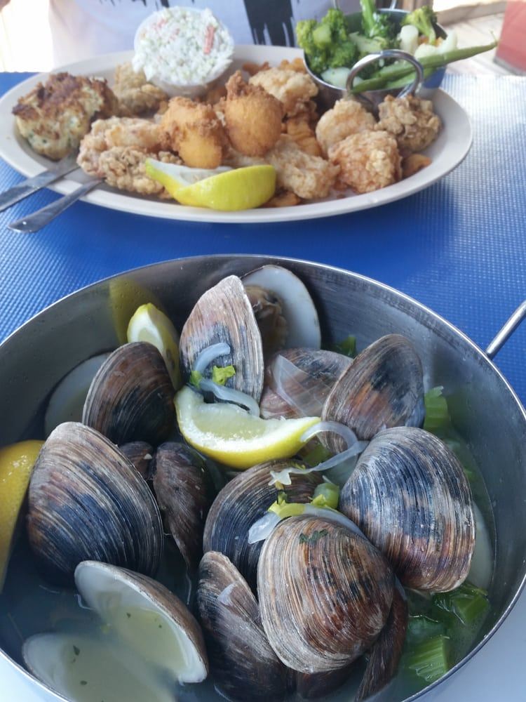 Photo of Phillippi Creek Oyster Bar - Sarasota, FL, United States. Seafood platter & steamed clams, YUM