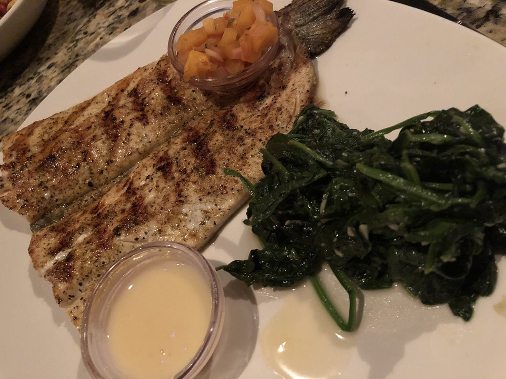 Photo of Bonefish Grill - Skokie, IL, United States. Rainbow trout n spinach - lovely