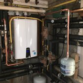Installation of a new Navian high efficiency condensing tankless water heater.