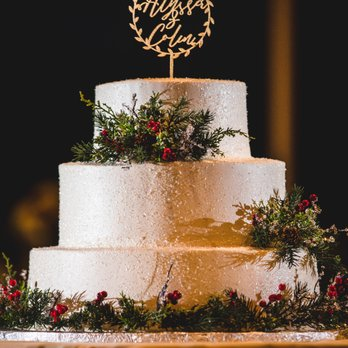 Wedding Cake Covered In Clear Edible Glitter With Greenery