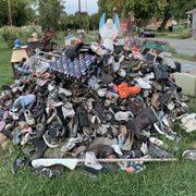 Photo of Heidelberg Project - Detroit, MI, United States. Mound of shoes