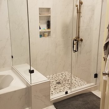 Custom Shower With A Bench And Shampoo