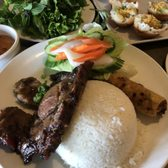 Photo of Vung Tau Restaurant - San Jose, CA, United States. Broken rice plate with pork chop and egg roll