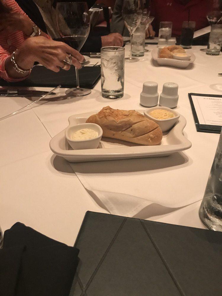 Photo of Flemings Prime Steakhouse & Wine Bar - Sarasota - Sarasota, FL, United States. Yummy bread & Butter