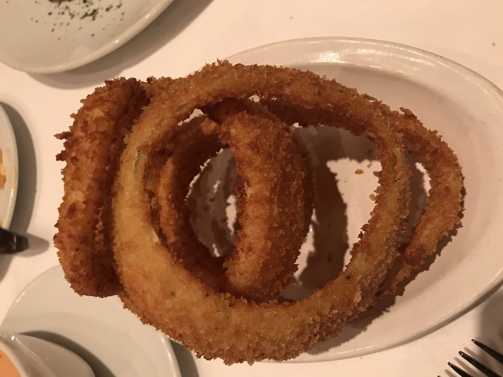 Photo of Flemings Prime Steakhouse & Wine Bar - Sarasota - Sarasota, FL, United States. Onion rings.