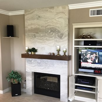 Hrc Added A Floor To Ceiling Tile Surround To The Fireplace
