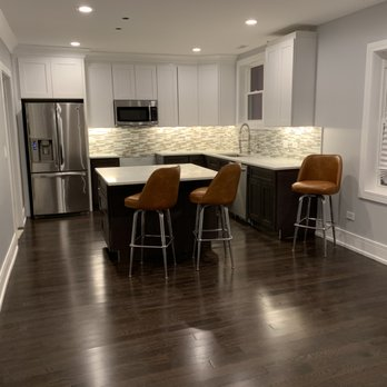 New kitchen cabinets, hardwood floor, walls, ceiling, trim ...