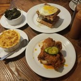 Photo of Revival - Minneapolis, MN, United States. Clockwise: Chicken + Waffle Breakfast Sandwich, 2 Piece Fried Chicken, Mac + Cheese, Collard Greens