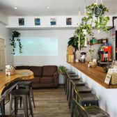 Photo of The Cafe - Long Beach, NY, United States. Love the surf scene on the wall.