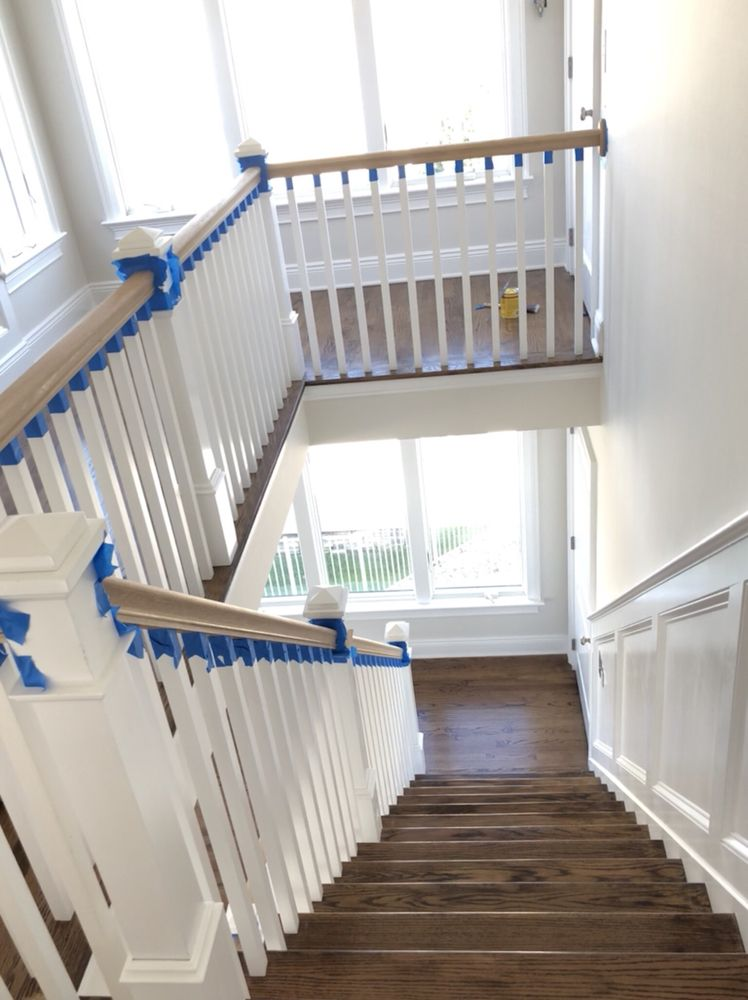 Hardwood floor refinished and stair