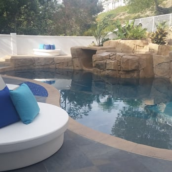 Contemporary pool design meets boulder waterfall and grotto ...