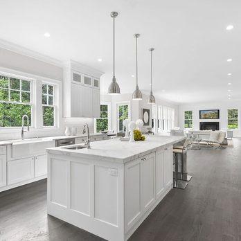 beautiful white kitchen with waterfall countertop - Yelp