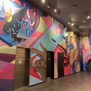 Photo of IPIC Theaters - Atlanta, GA, United States. Downstairs checkin art