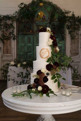 Photo of Shelby Lynns Cake Shoppe - Springdale, AR, US. Four-tier wedding cake (floral provided by Jules Floral Designs)