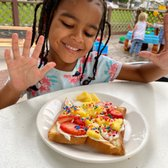 Photo of Keiki And The Pineapple - Honolulu, HI, United States. Keiki Unicorn Toast with a very happy keiki