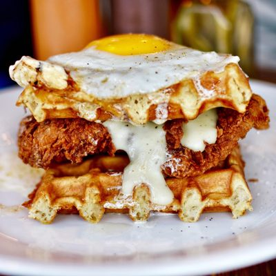 Photo of Revival - Minneapolis, MN, United States. Honey butter and syrup smothered fried chicken and waffle sandwich