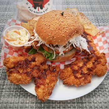 Photo of Fat Ninja Bite - Toronto, ON, Canada. Fat Ninja Bite - Chicken Katsu Burger, with katsu cuts from its full wingspan in order to fit the takeout box!