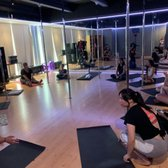 Photo of Yelp Fit Club: Fit For a Goddess - Honolulu, HI, United States. The workout room with poles