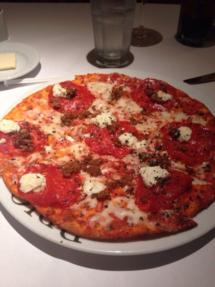 Photo of Brio Italian Grille - Sarasota, FL, United States. Sausage, pepperoni & ricotta flatbread