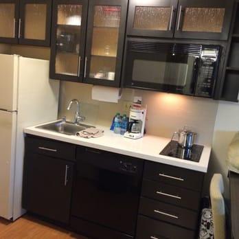Mini kitchen with electric stove, sink, dishwasher, standard ...