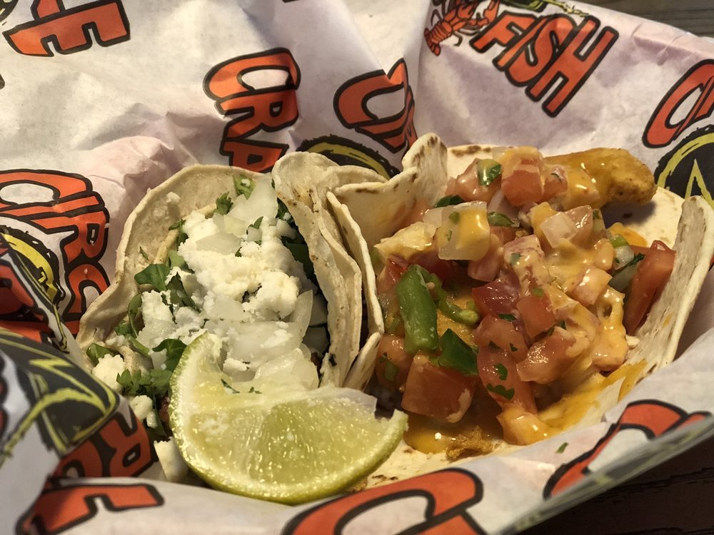 Photo of Circle M Crawfish - Big Sandy, TX, United States. Steak taco and chicken tender taco.