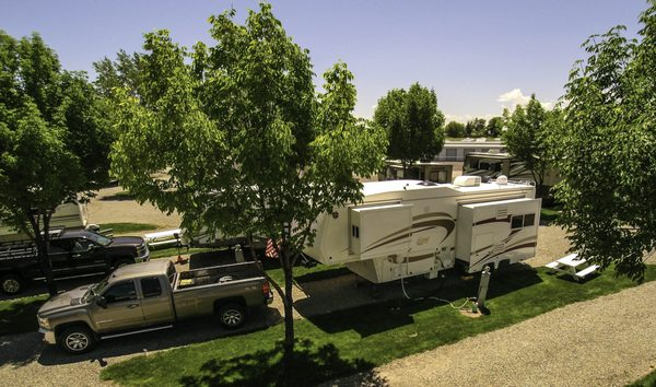 Photo of Twin Falls 93 RV Park - Filer, ID, US. Grassy green area with trees