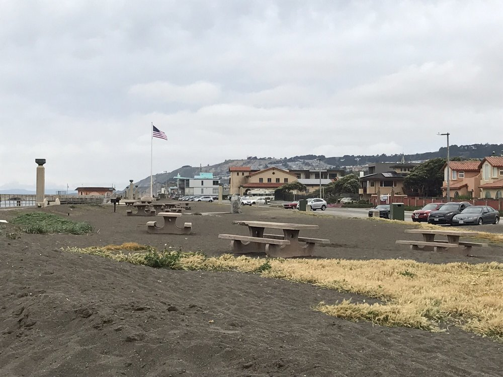 Photo of Sharp Park Beach - Pacifica, CA, United States. Picnic tables nearby
