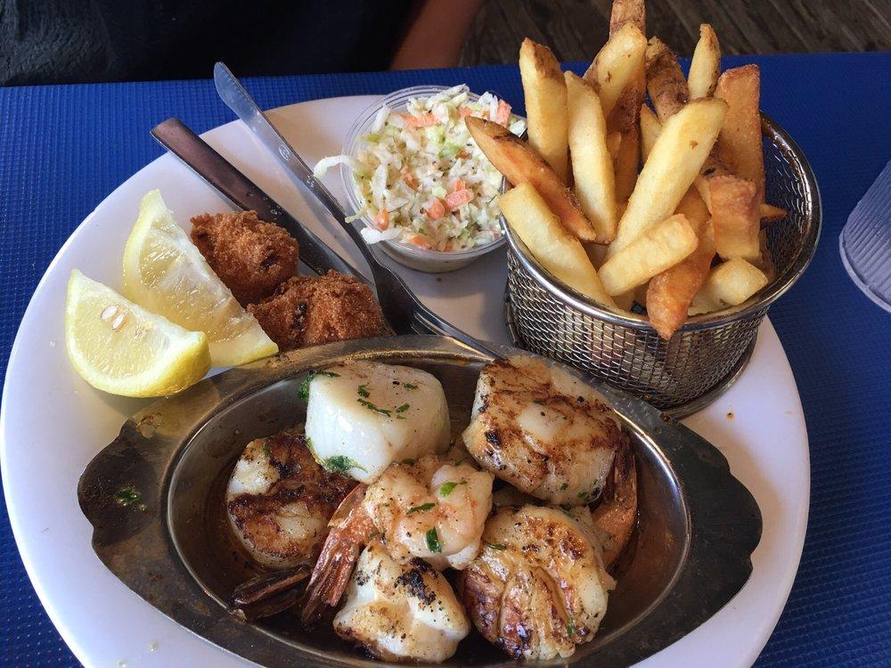 Photo of Phillippi Creek Oyster Bar - Sarasota, FL, United States. Sautéed Shrimp & Scallops ($23)