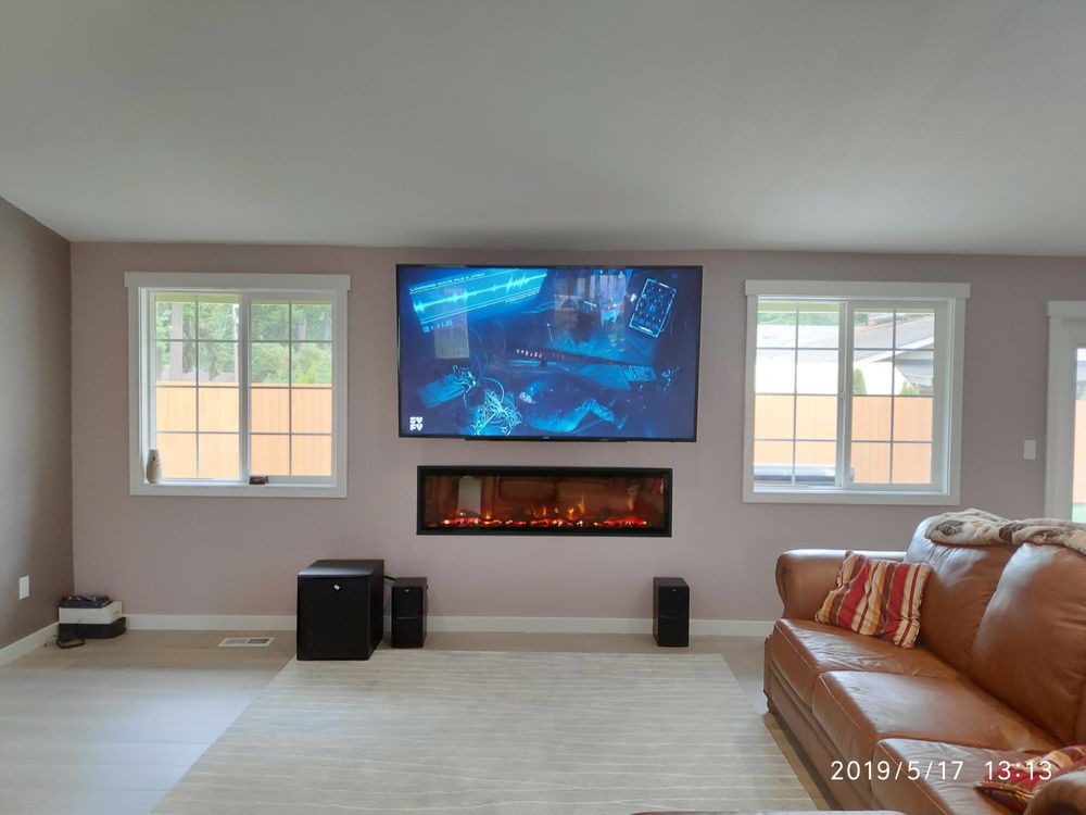 A Tv Mounted Over Fireplace With A Pull Down Mantel Mount Yelp