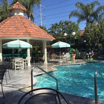 Photo of Candy Cane Inn - Anaheim, CA, United States. Poolside with birds singing away.