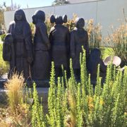 Photo of Autry Museum of the American West - Los Angeles, CA, United States. Unlabeled statue of Natives, front